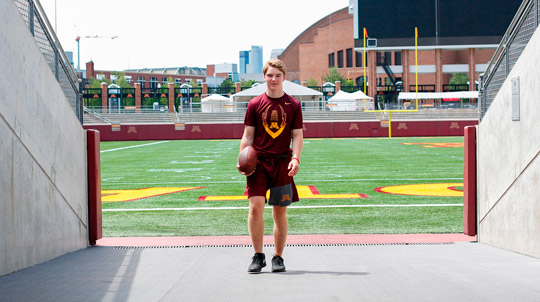 Young man standing in an entrance to TCF Bank field