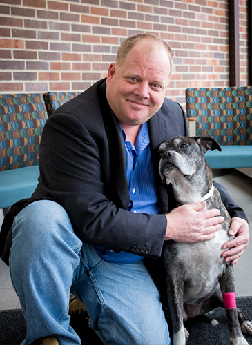 Michael Olin, Ph.D., with a dog