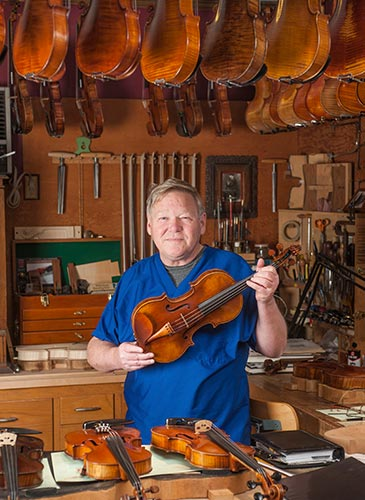 Steven Sirr, M.D., with a replica of the famous Betts violin