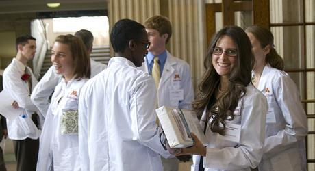 med students in white coats