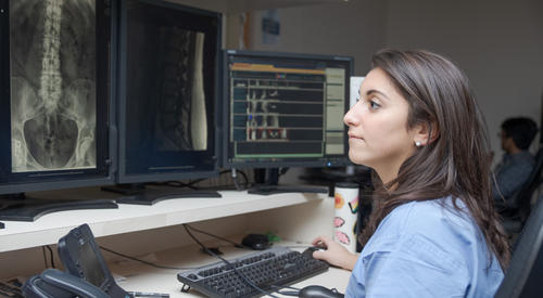 Female resident looking at image on the computer
