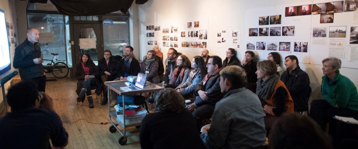 The new U of M course Global Health in a  Local Context met at a different community  setting each week during the fall semester.  In December they heard from Minneapolis  photographer Wing Young Huie at his studio.