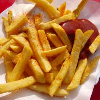 A serving of french fries and ketchup.